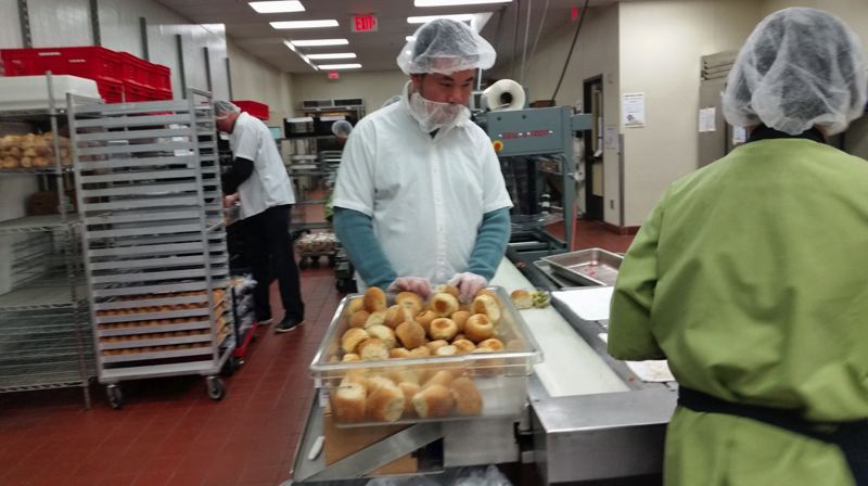CC - A student from the Community Transition Program works at an internship in the culinary field.