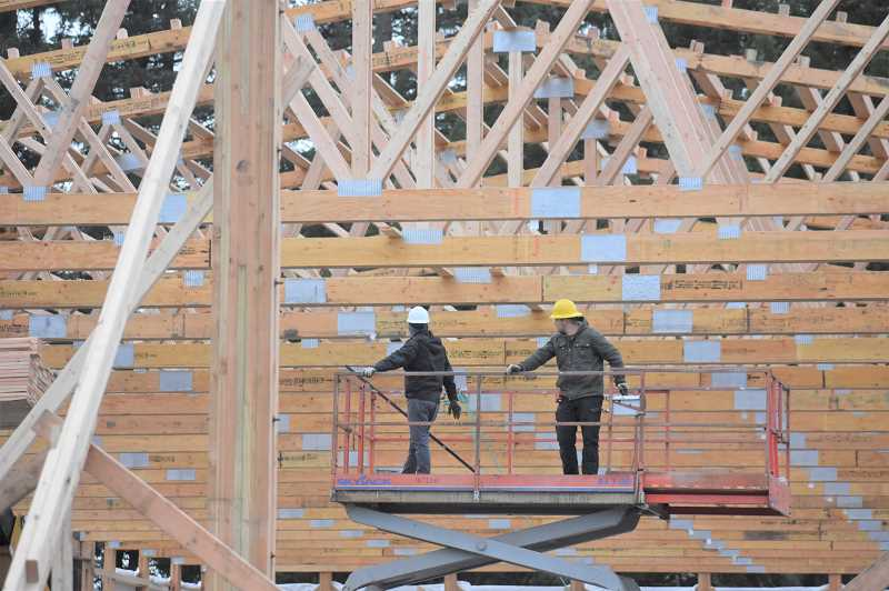 ESTACADA NEWS PHOTO: EMILY LINDSTRAND - Employees at Locke Buildings work on a warehouse for Working Concepts, a company that will relocate to Estacada later this year.