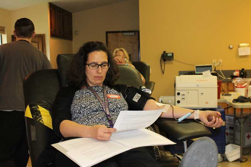 HOLLY BARTHOLOMEW - Art Tech English teacher Alexis Abrams gives blood at the Art Tech blood drive.