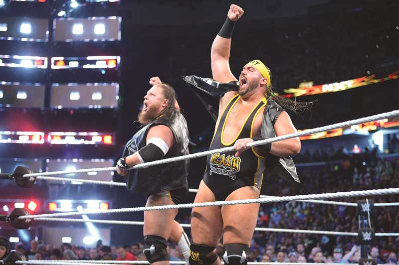 COURTESY WWE - Hubbard native Levi Cooper (right) and tag team partner Nikola Bogojevic are better known as Tucker Knight and Otis Dozovic in the WWE, forming the tag team duo Heavy Machinery