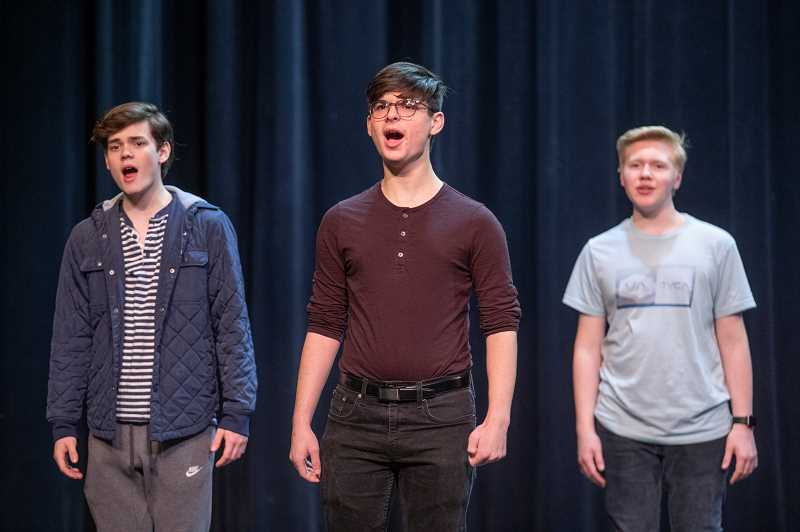 SPOKESMAN PHOTO: JONATHAN HOUSE - From left, Casey Young, Cormac Lister, and Chance Kirk sing during rehearsal with Wilsonville Highs Thespian Troupe for their upcoming Night on Broadway performance.