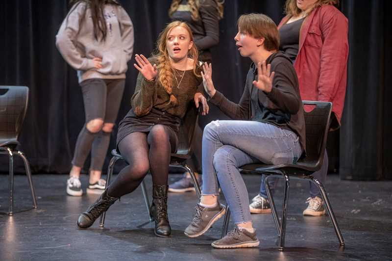 SPOKESMAN PHOTO: JONATHAN HOUSE - Mikaela Ochocki, left, and Katie Walter perform during rehearsal with Wilsonville Highs Thespian Troupe for the upcoming musical Night on Broadway.