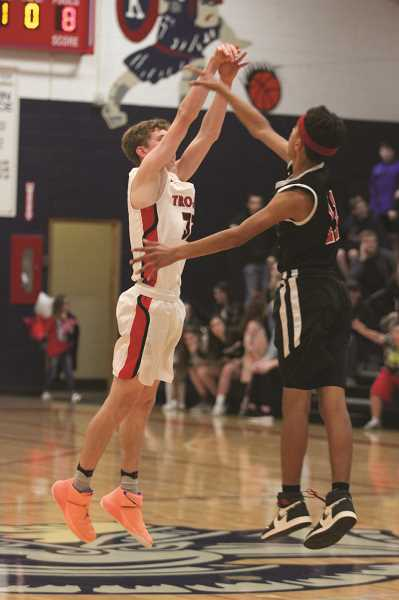 PHIL HAWKINS - Luke Hall and the No. 9 Kennedy Trojans rebounded from an upset loss to Chemawa the week prior by beating the No. 6 Sheridan Spartans by nearly 20 points on Jan. 14.