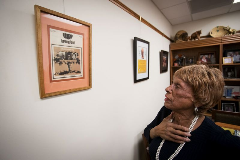 PAMPLIN MEDIA GROUP: JAIME VALDEZ - Winters, who was elected to the House in 1998, shows off a framed May 1980 newsletter, Turning Point, by the Republican National Committee. The newsletter cover featured photos of abolitionist author Frederick Douglass, Winters, center, and Republican Sen. Edward William Brooke III, the first African-American elected to the U.S. Senate.