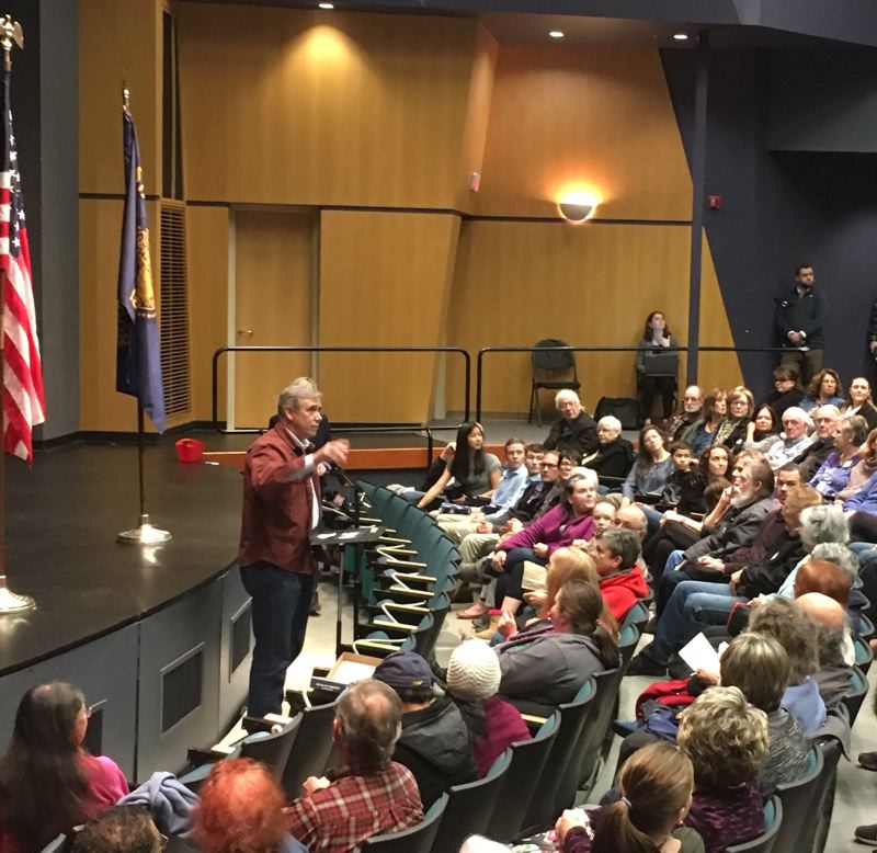 PAMPLIN MEDIA GROUP: PETER WONG - U.S. Sen. Jeff Merkley, D-Ore., makes a point during a town hall meeting Monday, Jan. 21, at Chemeketa Community College in Salem. He stands with Democratic colleagues who support funding of federal agencies prior to any discussion of President Donald Trump's demand for Congress to add $5.7 billion for a border wall with Mexico.