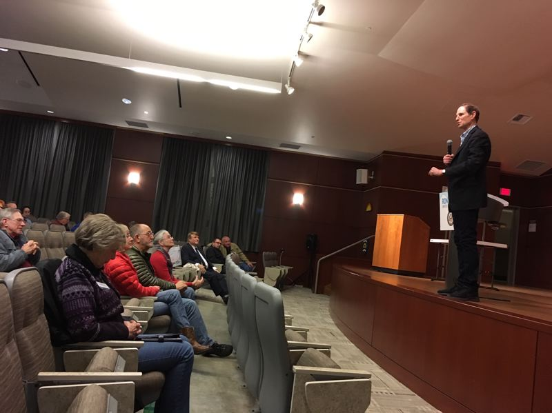 PAMPLIN MEDIA GROUP: PETER WONG - U.S. Sen. Ron Wyden, D-Ore., makes a point during a town hall meeting Sunday, Jan. 20, at Camp Withycombe in Clackamas. He stands with Democratic colleagues who support funding for federal agencies prior to any discussion of President Donald Trump's demand for Congress to add $5.7 billion for a border wall with Mexico.