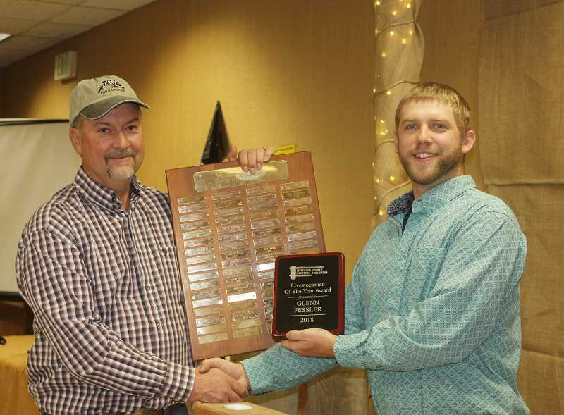 DESIREE BERGSTROM/MADRAS PIONEER - Livestock association president Mark Wunsch, right, presents the Livestockman of the Year Award to rancher Glenn Fessler.
