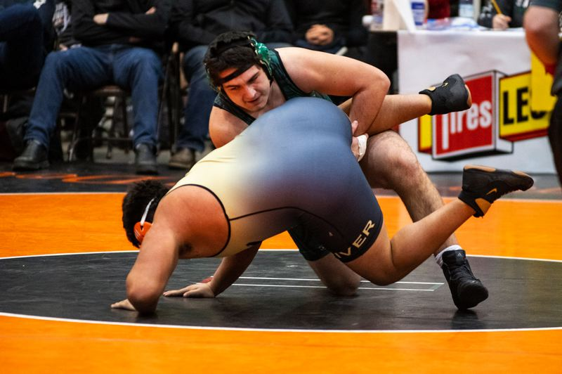 PAMPLIN MEDIA: LON AUSTIN - Hunter Gotchall works to turn his opponent during the Rangers win over Henley at last weekends Oregon Wrestling Classic.