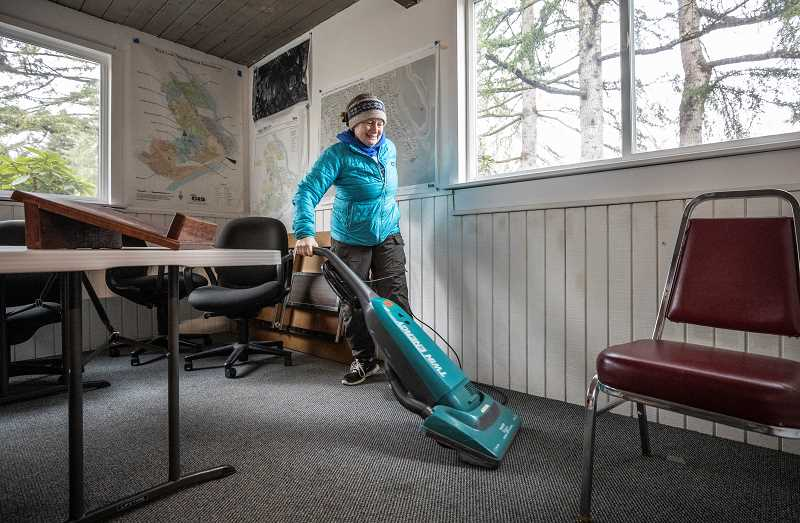 TIDINGS PHOTO: JONATHAN HOUSE - Sharon Selvaggio helped vacuum and clean inside of Robinwood Station for MLK Day.