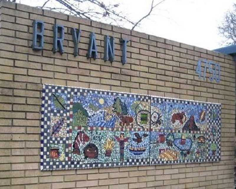 REVIEW FILE PHOTO - Artist Mark Brody helped students create this freestanding mosaic panel, which sits in front of Bryant Elementary School.
