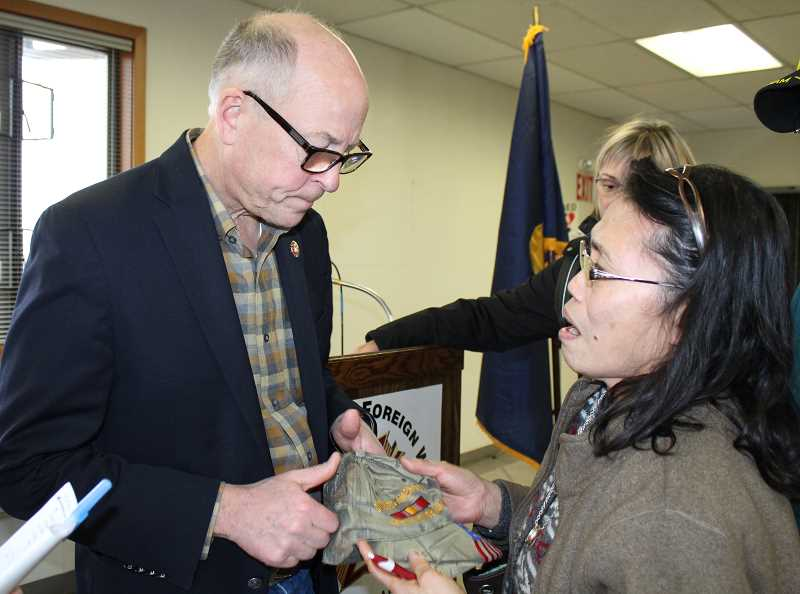 HOLLY M. GILL/MADRAS PIONEER - Dorotea Duback, of Madras, talks with U.S. Rep. Greg Walden at the Jan. 20 town hall.