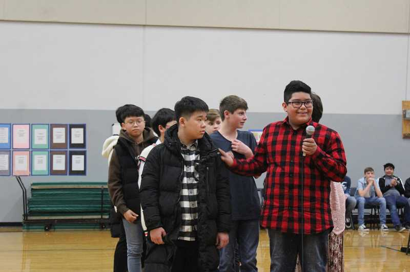 KRISTEN WOHLERS - Baker Prairie student Armando Alfaro-Negrete introduces his guest from South Korea at the welcoming ceremony Wednesday, Jan. 16.