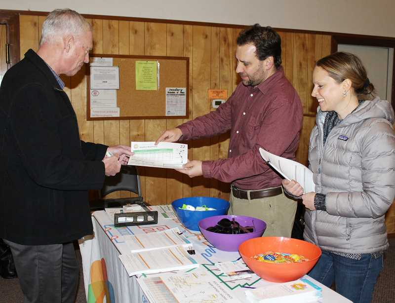 HOLLY M. GILL/MADRAS PIONEER - Jeff Monson, left, executive director of Commute Options, of Bend, and Derek Hofbauer and Andrea Breault, of Cascade East Transit, hold an open house at the Jefferson County Library's Rodriguez Annex on Jan. 17, to gather input for their master plan.