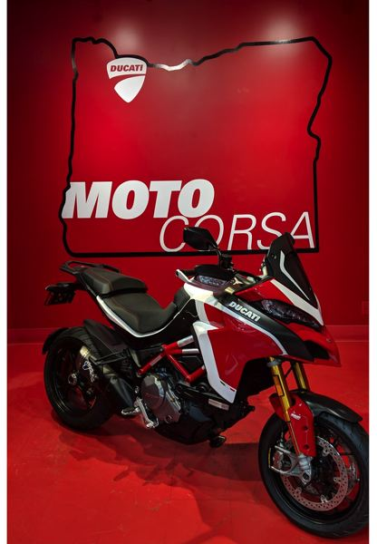 PHOTOS: COURTESY DUCATI AMERICA - A Ducati Multistrada 1260 Pikes Peakin MotoCorsa's red room, where buyers pose for photos with their new bikes.