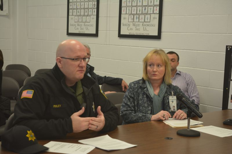 SPOTLIGHT PHOTO: COURTNEY VAUGHN - Sheriff Brian Pixley addresses Columbia County commissioners Wednesday, Jan. 23, to advocate for a new permanent position within the Sheriffs Office. To the right, Human Resources Director Jean Ripa.