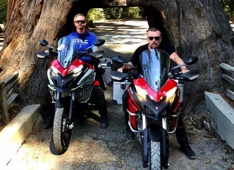 COURTESY: BILLY DUFFY - Ducati America CEO Jason Chinnock (left) with his pal Billy Duffy of UK rock band The Cult, riding Ducati Multistrada motorcycles on a bro trip from San Francisco to Ashland. They talked bikes and guitars for the first three days then just enjoyed the scenery, Chinnock told the Business Tribune.