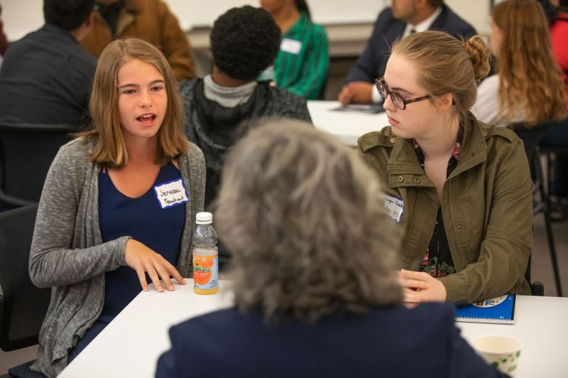 PAMPLIN MEDIA GROUP FILE PHOTO - High School student Akili Kelekele, left, and statee Rep. Diego Hernandez, along with more students, chat during a Joint Legislation Committee on School Success town hall.