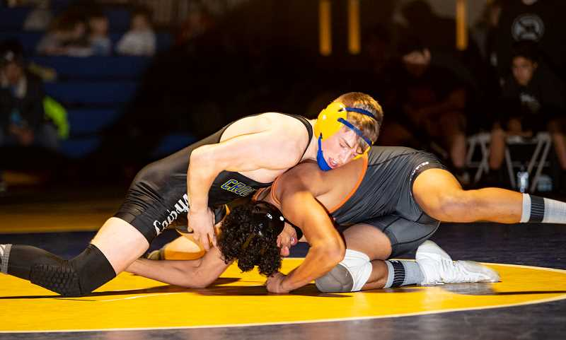 LON AUSTIN/CENTRAL OREGONIAN - Gavin McLean works to control Isaiah Toomey during their 160-pound match Tuesday. McLean went on to win 6-0, while the Cowboys rolled past Culver 46-12 to win the Cowdog Classic.