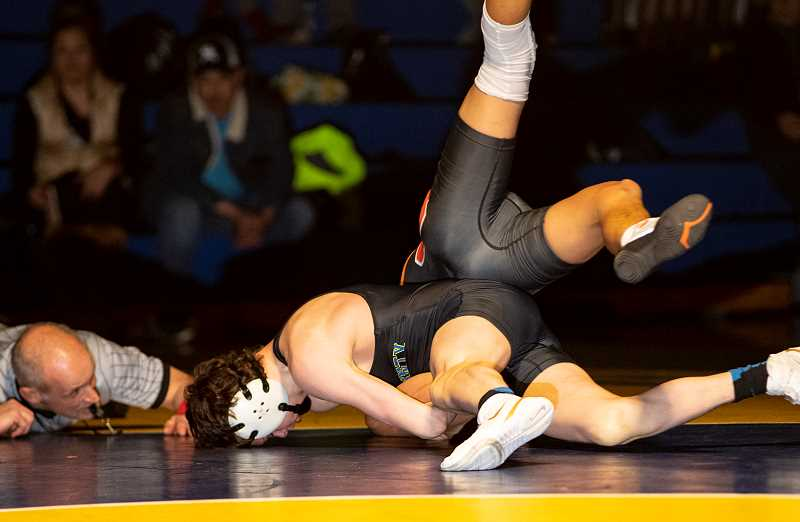 LON AUSTIN/CENTRAL OREGONIAN - In one of the most anticipated matches in the dual, Crook County's Hunter Mode took an 8-0 decision over defending Class 2A state champion Lorenzo Vasquez in their 126-pound match.