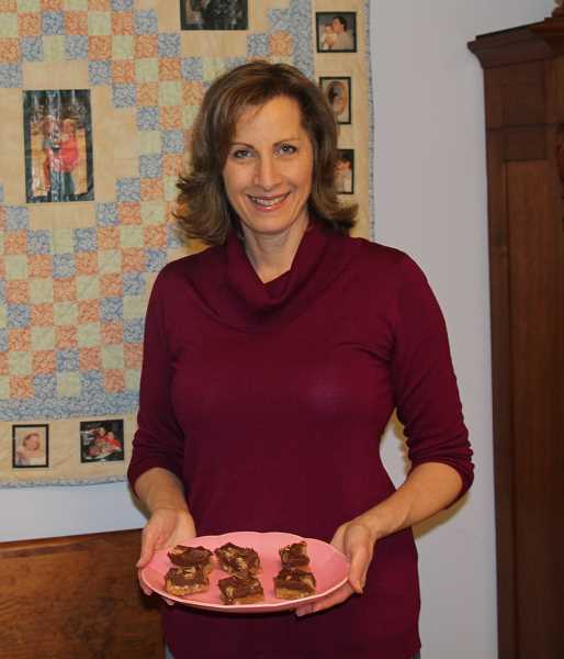 WOODBURN INDEPENDENT: JUSTIN MUCH - Joanna Crumley of Hubbard shows a dish of her Pillsbury bake-off winning REESEs Piece O Bliss Fudge. She was among four winners in the national bake off and will be featured on the Food Network show Kitchen in February.