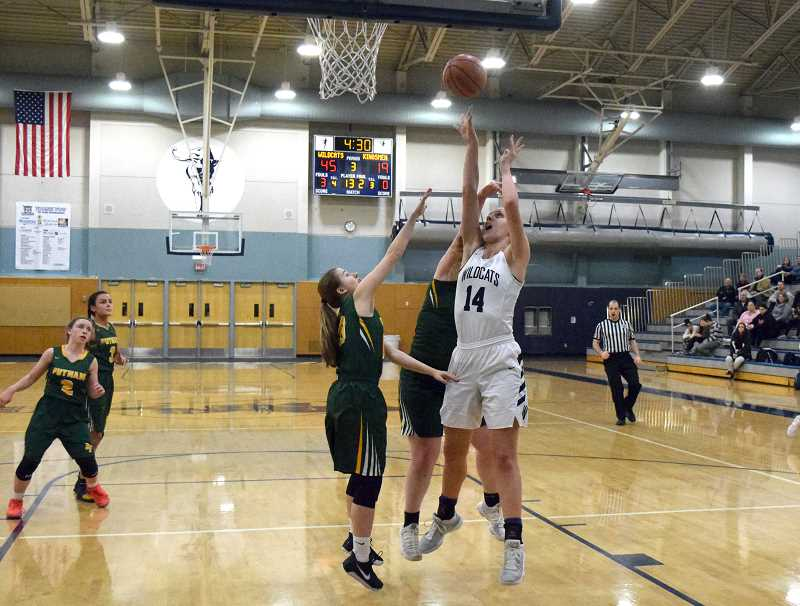 SPOKESMAN PHOTO: TANNER RUSS - WIlsonvilles Emilia Bishop led the Wildcats in the score total with 16 points and numerous rebounds in the paint.