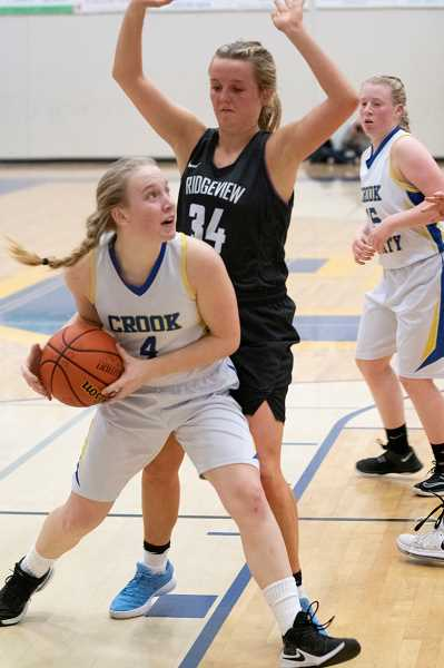 LON AUSTIN/CENTRAL OREGONIAN - Josie Kasberger makes a move to the basket against a taller Ridgeview player. Kasberger led the Cowgirls in scoring with 12 and pulled down nine rebounds, but it wasn't enough as Ridgeview won the game 55-32