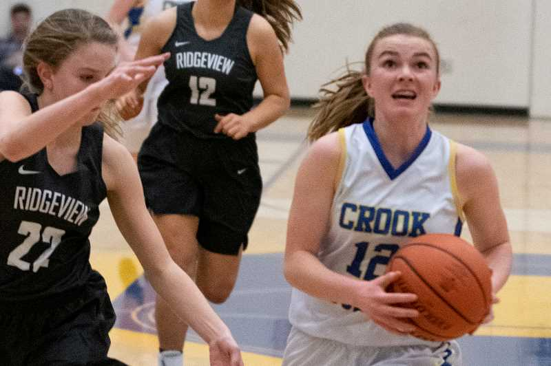 LON AUSTIN/CENTRAL OREGONIAN - Dallas Hutchins scored seven points and added a game-high 10 rebounds for the cowgirls.