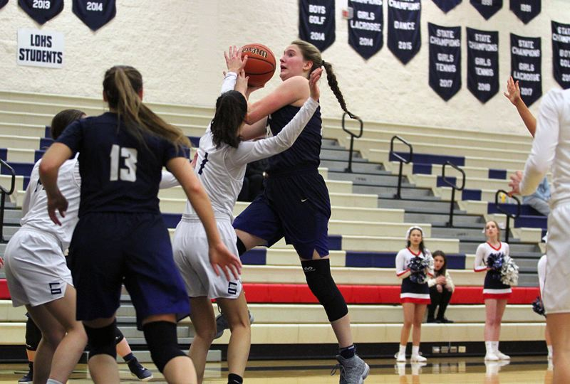 PAMPLIN MEDIA GROUP PHOTO: MILES VANCE - Canby junior Nicole Mickelson goes up for a shot during her team's 77-75 triple overtime win over Lake Oswego at Lake Oswego High School on Friday.