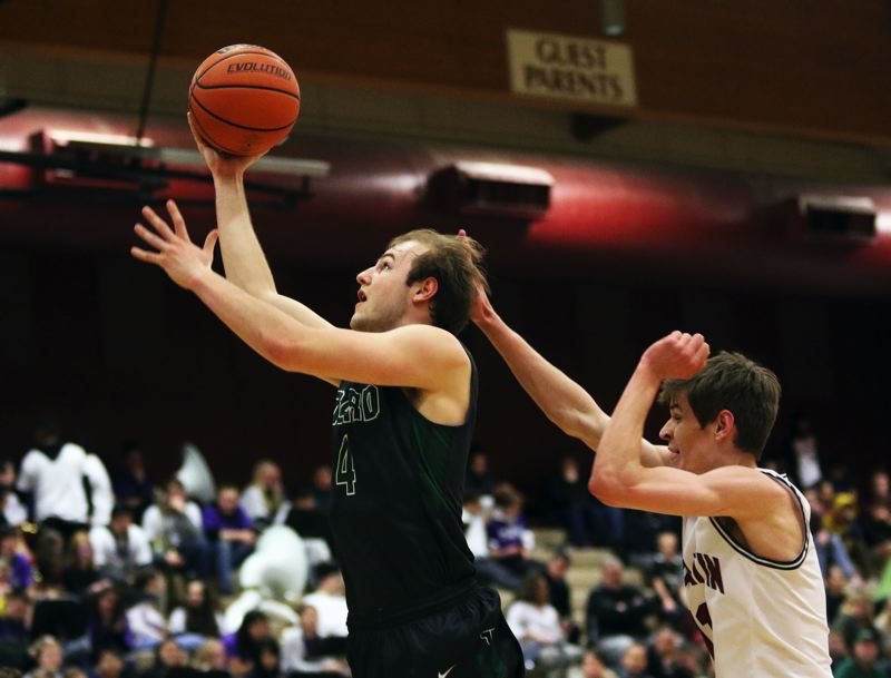 TIMES PHOTO: DAN BROOD - Tigard High School senior Stevie Schlabach (left) goes to the basket for two of his 33 points for the Tigers in their 75-72 win at Tualatin on Friday.