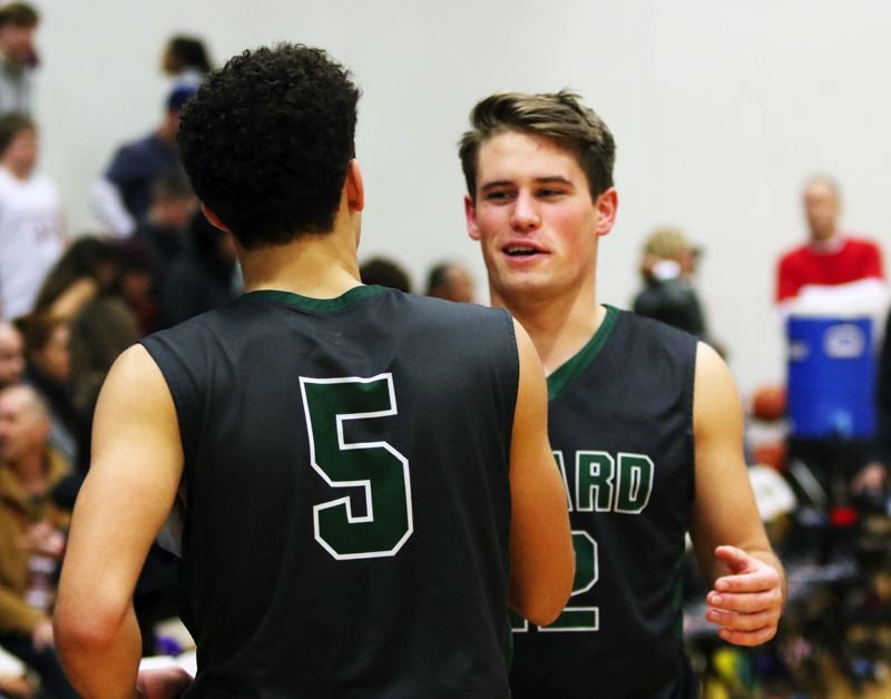 TIMES PHOTO: DAN BROOD - Tigard senior Carson Crist (right) smiles with sophomore Drew Carter following the Tigers' 75-72 win at Tualatin on Friday.