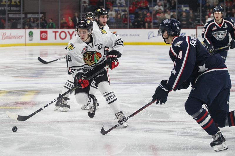 COURTESY: MATTHEW WOLFE/PORTLAND WINTERHAWKS - Cody Glass (left) handles the puck for the Portland Winterhawks in their game last week against Tri-City.