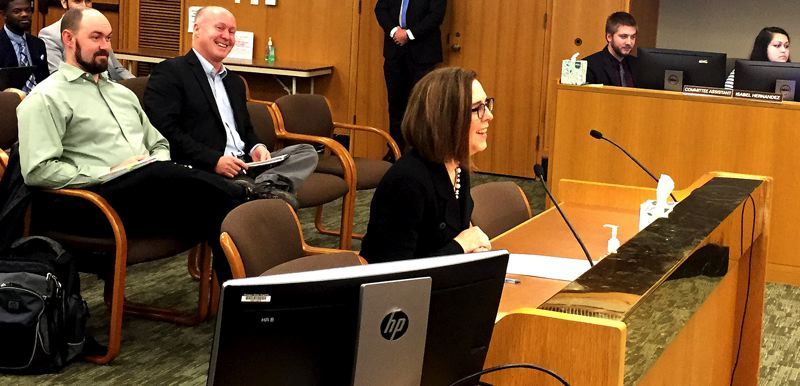 PAMPLIN MEDIA GROUP: PARIS ACHEN - Patrick Starnes listened as Gov. Kate Brown testified Wednesday, Jan. 23, to the state Senate Committee on Finance, supporting a campaign finance proposal that Starnes supports.