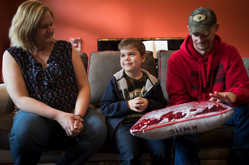 PORTLAND TRIBUNE: JAIME VALDEZ - Erin and Chris Heading are happy to be heading back home to Eagle Point after their son, Samuel, 5, after their stay at Ronald McDonald's East House.