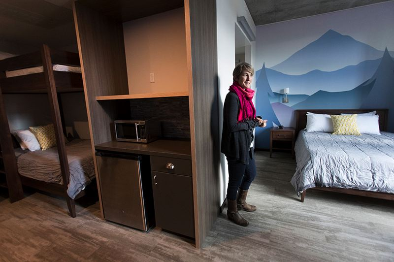 PORTLAND TRIBUNE: JAIME VALDEZ - Jessica Miller conducts a tour of the new facility, which is larger than the former house in Portland.