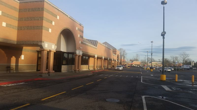 PHOTO BY RAYMOND RENDLEMAN - Even on a sunny afternoon, most of the 702 parking spaces at the Milwaukie Marketplace mall are unoccupied following the exit of key tenants.