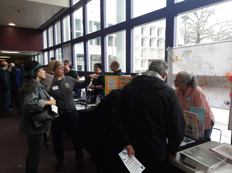 STAFF PHOTO: MARK MILLER - Stacy Metzger, second from left, and Nancy Monroe, right, talk to attendees of Saturday's town meeting at Forest Grove High School about the Map Your Neighborhood program.