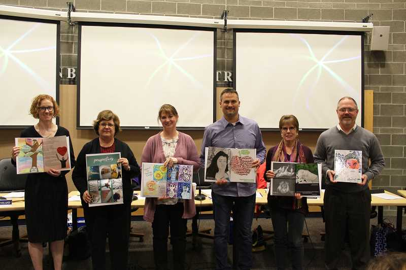 KRISTEN WOHLERS - Canby's school board members show off the art books they received at the January meeting. The members are from left to right: Angi Dilkes Perry, Andrea Weber, Sara Magenheimer, Tom Scott, Diane Downs and Rob Sheveland. Mike Zagyva is not pictured.