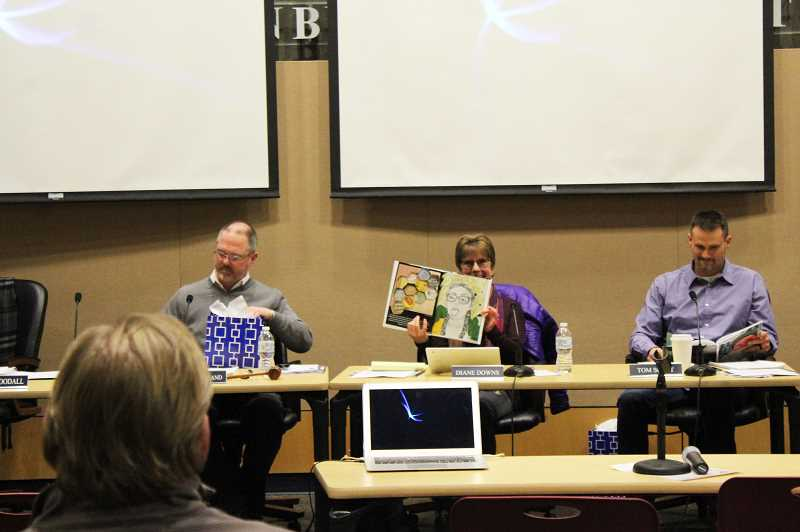 KRISTEN WOHLERS - School board member Diane Downs shows some of the Canby student artwork published in the book.