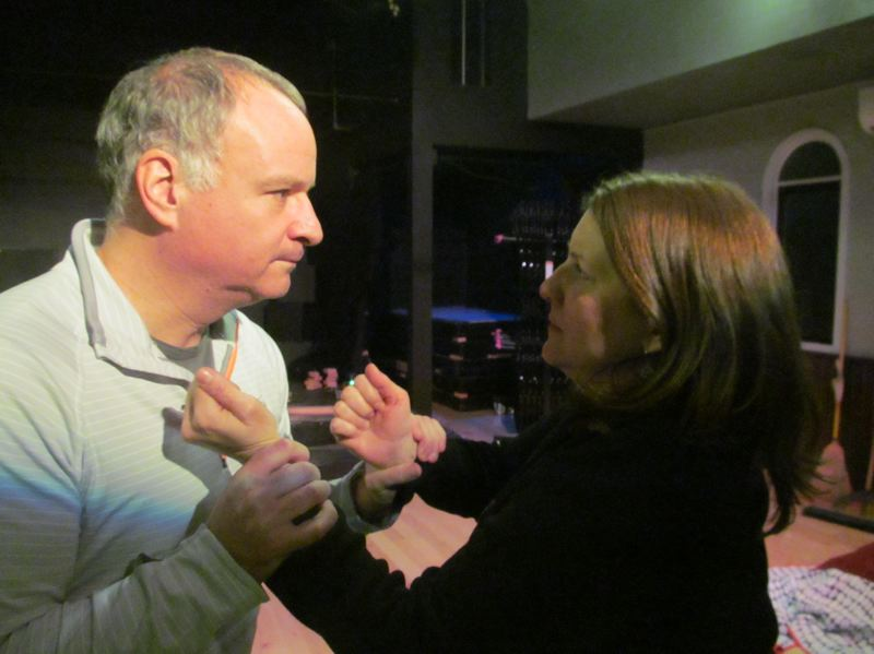PHOTO BY DICK TRTEK - Jason Glick and Danielle Weathers rehearse a dramatic moment in 'Friends with Guns,' which opens at the Chapel Theatre on Jan. 31.
