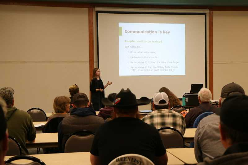 COURTESY OF SAIF - Chelsea Imdieke, a safety consultant at SAIF, conducts a ag-worker safety seminar in 2018.