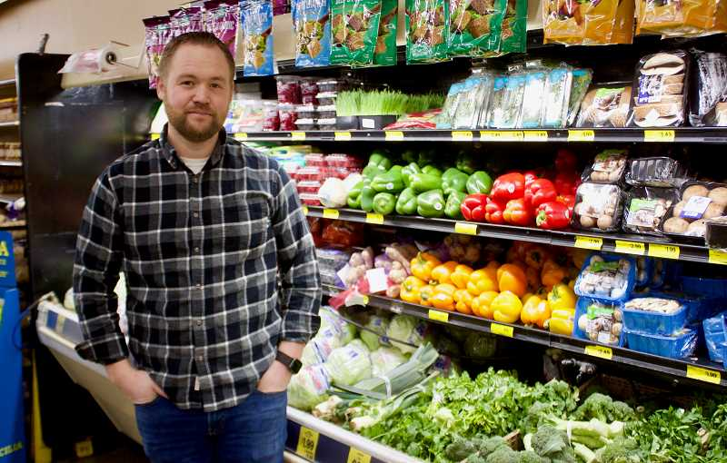 STAFF PHOTO: CHRISTOPHER KEIZUR - Corey Price, owner of the Gresham Grocery Outlet, started composting as a way to be a better steward of the environment and community.
