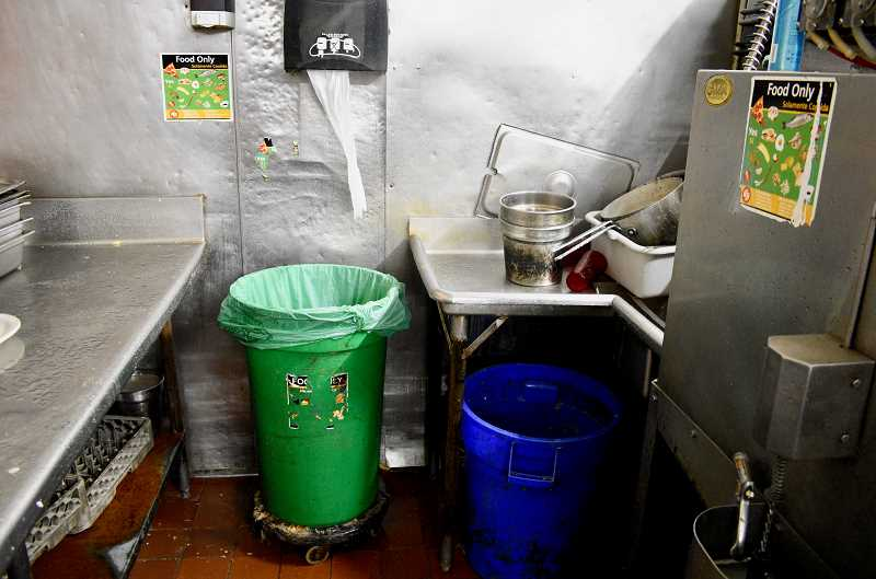 STAFF PHOTO: CHRISTOPHER KEIZUR - At La Carreta of Gresham, its a simple process to compost — food scraps in the green bin, garbage in the blue.