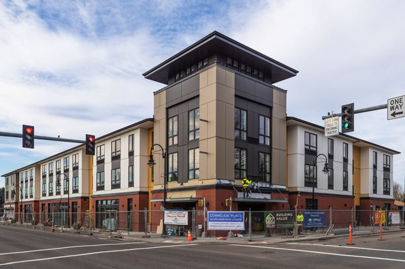 STAFF PHOTO: CHRISTOPHER OERTELL - Cornelius Place, with the new home of the Cornelius Public Library on its ground floor and 45 apartment units on its second and third floors, is an eye-catching addition to the Highway 8 corridor through downtown Cornelius.
