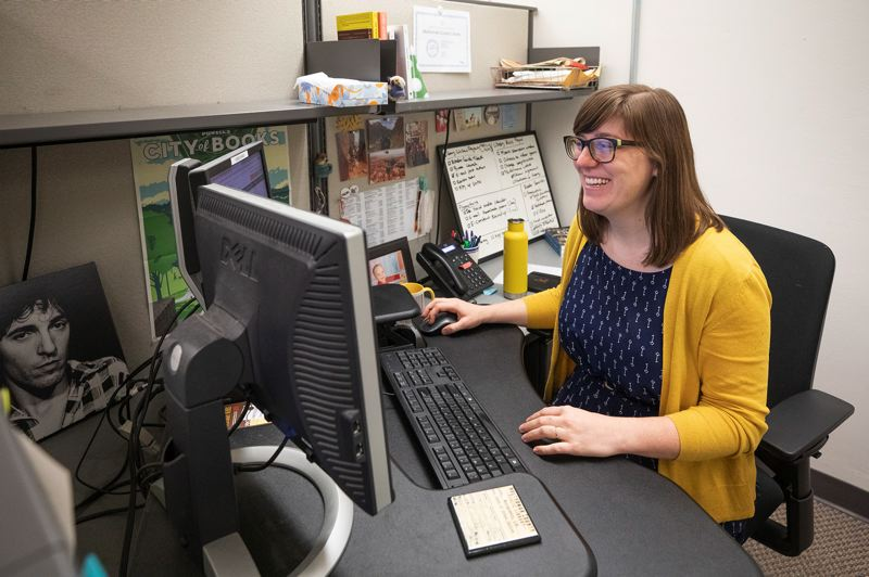 TRIBUNE PHOTO: JONATHAN HOUSE  - Electronic content librarian Kady Ferris is constantly searching for new titles to add to the Multnomah County Librarys version of the OverDrive app.