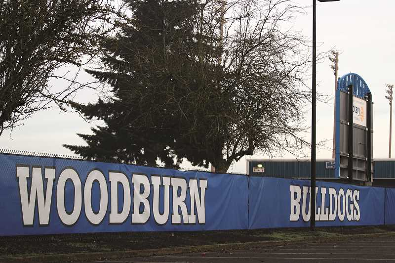 PHIL HAWKINS - The field at Woodburn High School's Pat Cary Track & Field Facility will be replaced with artificial turf this spring.