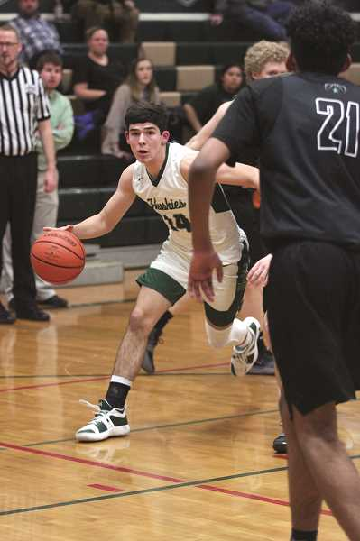 PHIL HAWKINS - North Marion senior Grant Henry scored nine of his 11 points from beyond the arc on Jan. 22 against Estacada.
