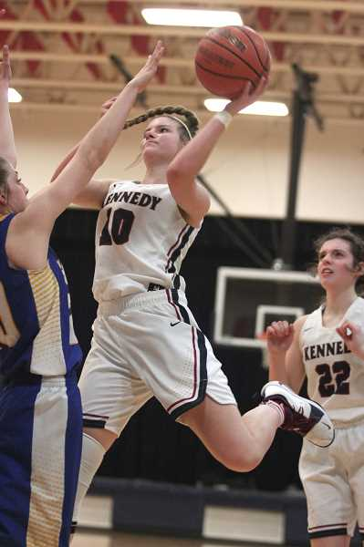PHIL HAWKINS - Kennedy senior Kalyssa Kleinschmit scored the final 10 points for the Trojans in their 53-40 win over Kennedy on Friday.
