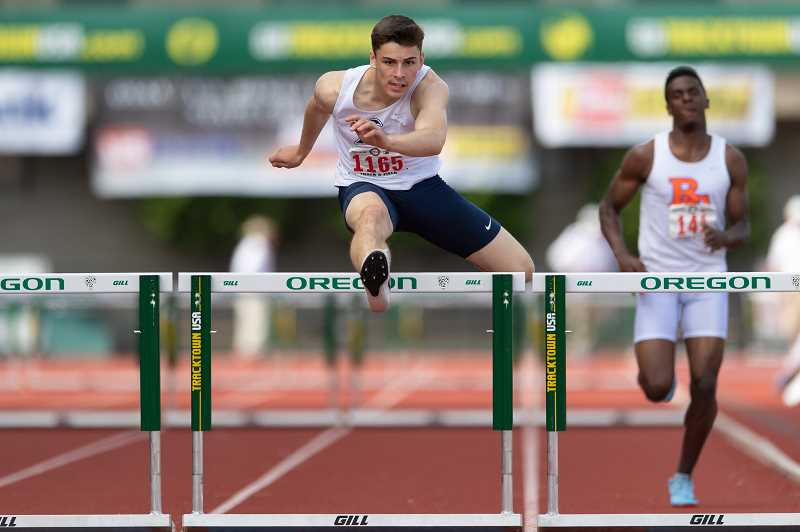 STAFF PHOTO: CHRISTOPHER OERTELL - Liberty's Aidan Maloney competes in the hurdles at last year's OSAA State Track and Field Championships at Hayward Field in Eugene.