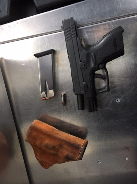 PPB PHOTO - Police claim this loaded firearm was confiscated during an investigation.