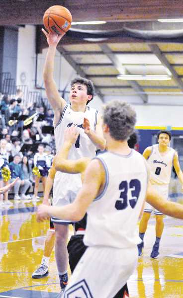 GARY ALLEN - Junior guard Jack Chlumak attempts a floater during Newberg's 46-43 win over McMinnville on Jan. 25.